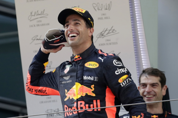 Red Bull driver Daniel Ricciardo of Australia celebrates on the podium after winning the Chinese Formula One Grand Prix at the Shanghai International Circuit in Shanghai, Sunday, April 15, 2018. (AP Photo/Andy Wong)