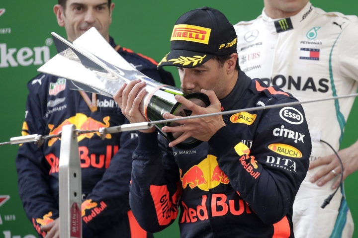 Red Bull driver Daniel Ricciardo of Australia kisses his trophy as he celebrates after winning the Chinese Formula One Grand Prix at the Shanghai International Circuit in Shanghai, Sunday, April 15, 2018. (AP Photo/Andy Wong)