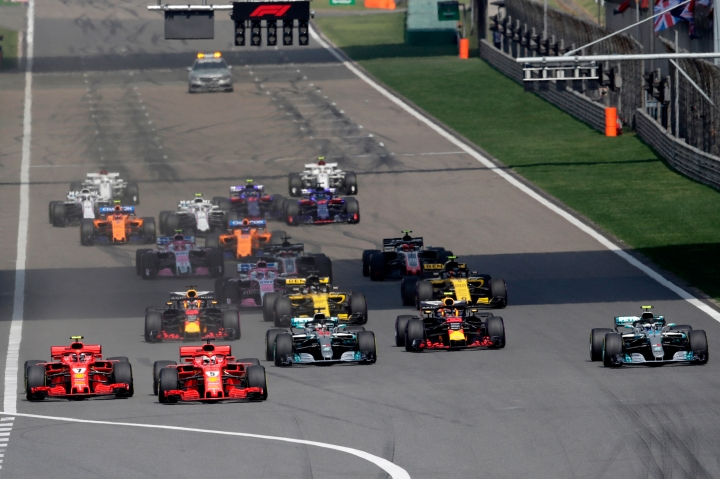 Ferrari driver Sebastian Vettel (5) of Germany leads the field at the start of the Chinese Formula One Grand Prix at the Shanghai International Circuit in Shanghai, Sunday, April 15, 2018. (AP Photo/Andy Wong)
