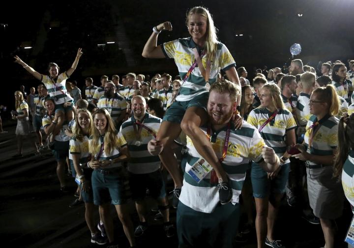 Australian athletes pose for photos during the closing ceremony at Carrara Stadium during the 2018 Commonwealth Games on the Gold Coast, Australia, Sunday, April 15, 2018. (AP Photo/Dita Alangkara)