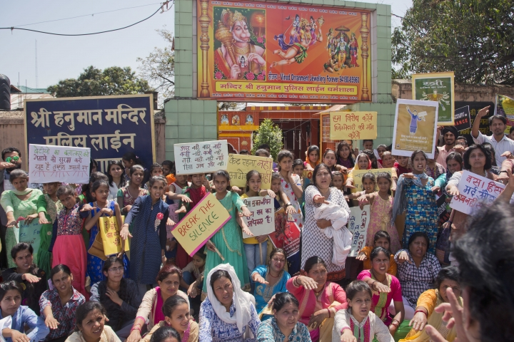 Indian women shout slogans during a protest after gathering in front of a temple of Hindu god Hanunan, to condemn violence against women in Dharmsala, India, Sunday, April 15, 2018. Violent crimes against women have been on the rise in India despite tough laws enacted in 2013. (AP Photo/Ashwini Bhatia)