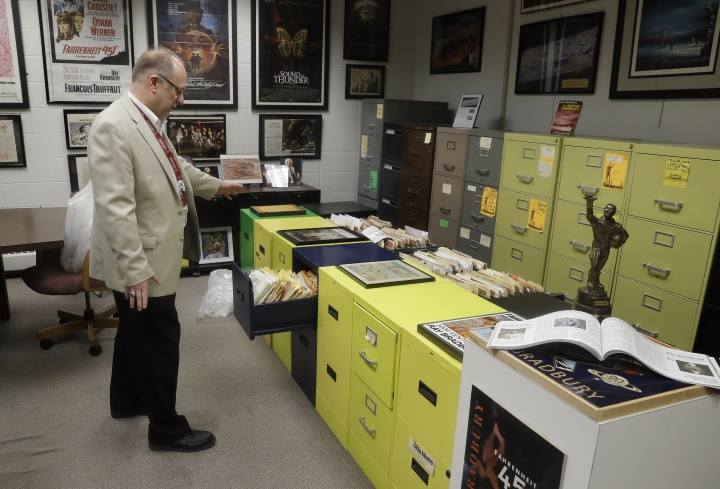 In this Thursday, April 12, 2018, photo, Center for Ray Bradbury Studies director Jonathan Eller talks about the archival area of the Center for Ray Bradbury Studies includes the author's files in the original filing cabinets from his homes in Los Angeles and Palm Springs, in Indianapolis. (AP Photo/Darron Cummings)