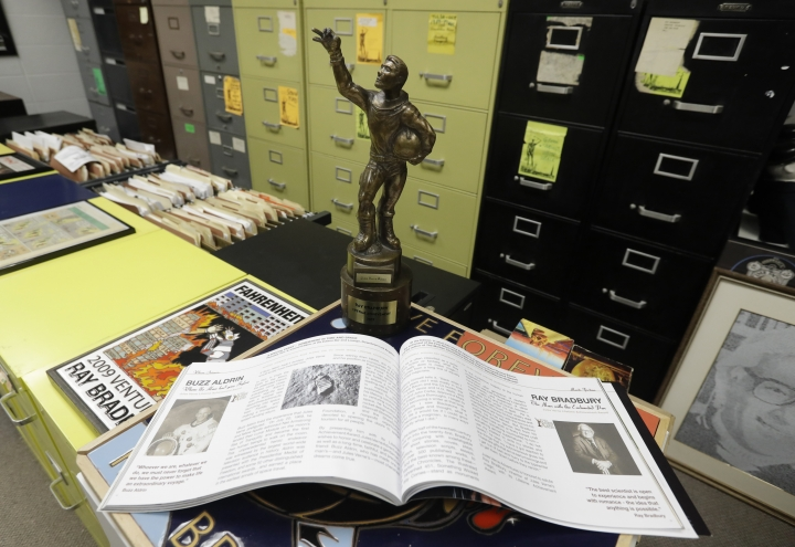 In this Thursday, April 12, 2018, photo, The Center's displays include the Jules Verne Lifetime Achievement Award is pictured, in Indianapolis. The award was presented to Ray Bradbury in 2007 for his lifelong advocacy of space exploration. (AP Photo/Darron Cummings)