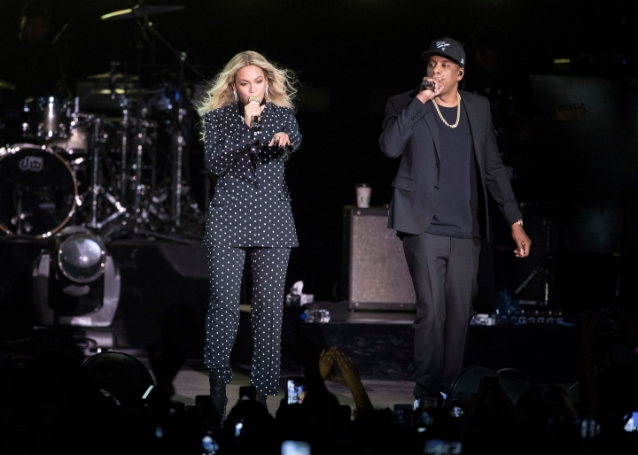 FILE - In this Nov. 4, 2016 file photo, Beyonce, center, and Jay-Z perform during a Democratic presidential candidate Hillary Clinton campaign rally in Cleveland. Beyonce performed a 2-hour set at Coachella, Saturday, April 14, 2018, paying tribute to the marching bands, the dance troupes and step teams at historically black colleges and universities. Jay-Z also came out for a collaboration.( AP Photo/Matt Rourke, File)