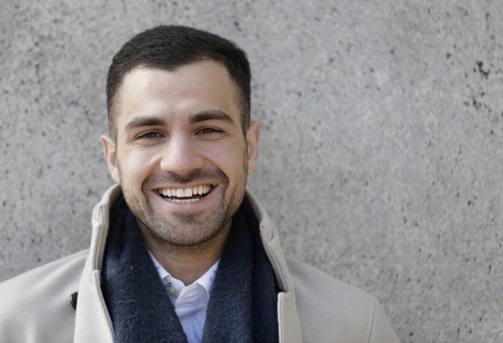In this April 2, 2018 photo, Qutaiba Idlbi poses for a picture at Columbia University in New York where he is a sophomore. A scholarship program that Columbia created to support Syrians who, like Idlbi, were displaced by war, could be jeopardized by the travel restrictions that President Trump has imposed on citizens of that country. (AP Photo/Seth Wenig)