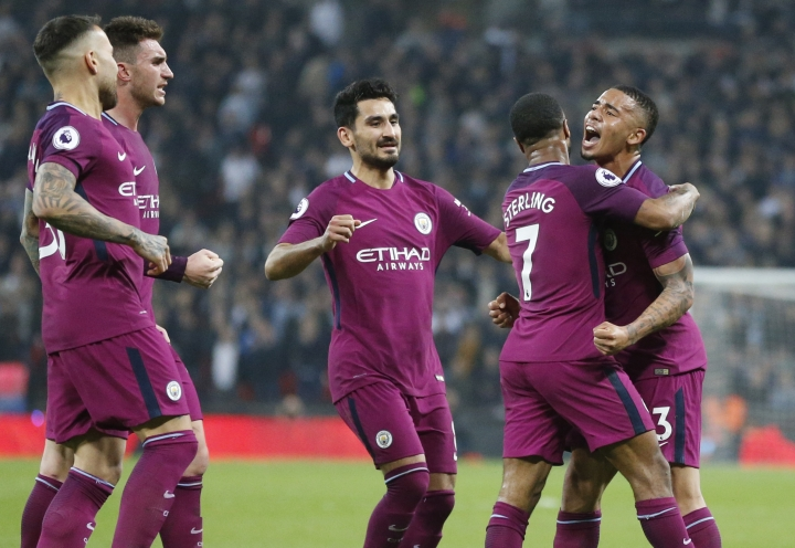Manchester City's Raheem Sterling, second from right, celebrates with team mates after scoring his sides third goal during the English Premier League soccer match between Tottenham Hotspur and Manchester City at Wembley stadium in London, England, Saturday, April 14, 2018. (AP Photo/Frank Augstein)