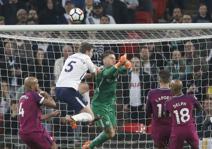 Manchester City goalkeeper Ederson makes a save during the English Premier League soccer match between Tottenham Hotspur and Manchester City at Wembley stadium in London, England, Saturday, April 14, 2018. (AP Photo/Frank Augstein)