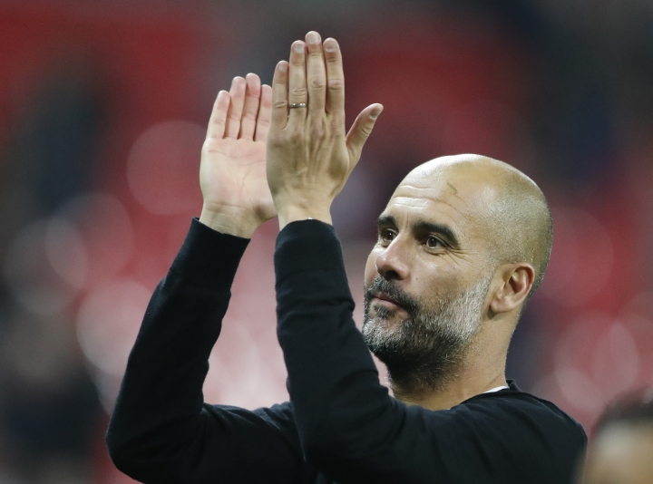Manchester City manager Pep Guardiola applauds the fans as he walks from the pitch after the end of the English Premier League soccer match between Tottenham Hotspur and Manchester City at Wembley stadium in London, England, Saturday, April 14, 2018. (AP Photo/Frank Augstein)