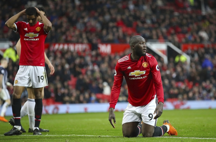 Manchester United's Romelu Lukaku shows his dejection after the final whistle of the English Premier League soccer match against West Bromwich Albion at Old Trafford, Manchester, England, Sunday April 15, 2018. (Nick Potts/PA via AP)