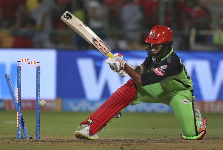 Royal Challengers Bangalore batsman Washington Sundar is bowled out by Rajasthan Royals Ben Stokes during the VIVO IPL Twenty20 cricket match in Bangalore, India, Sunday, April 15, 2018. (AP Photo/Aijaz Rahi)