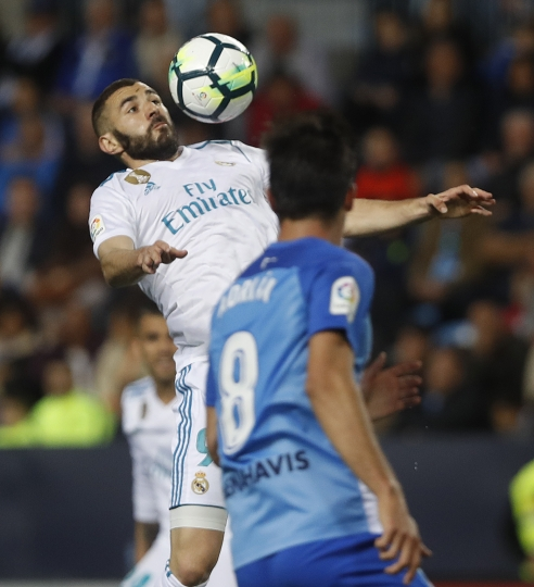 Real Madrid's Benzema, controls the ball during the La Liga soccer match between Real Madrid and Malaga at the Rosaleda stadium, in Malaga, Spain on Sunday, April. 15, 2018. (AP Photo/Miguel Morenatti)