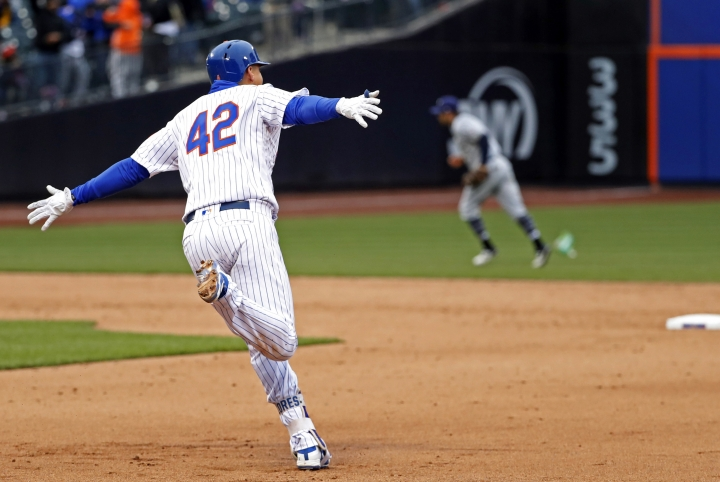 New York Mets Wilmer Flores runs the bases after hitting a walk-off, solo home run in the ninth inning of a baseball game against the Milwaukee Brewers, Sunday, April 15, 2018, in New York. (AP Photo/Kathy Willens)