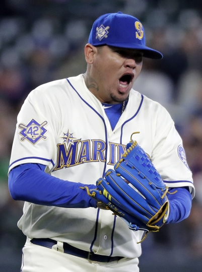 Seattle Mariners starting pitcher Felix Hernandez pounds his glove and yells after striking out Oakland Athletics' Matt Olson to end the top of the sixth inning during a baseball game Sunday, April 15, 2018, in Seattle. (AP Photo/Elaine Thompson)