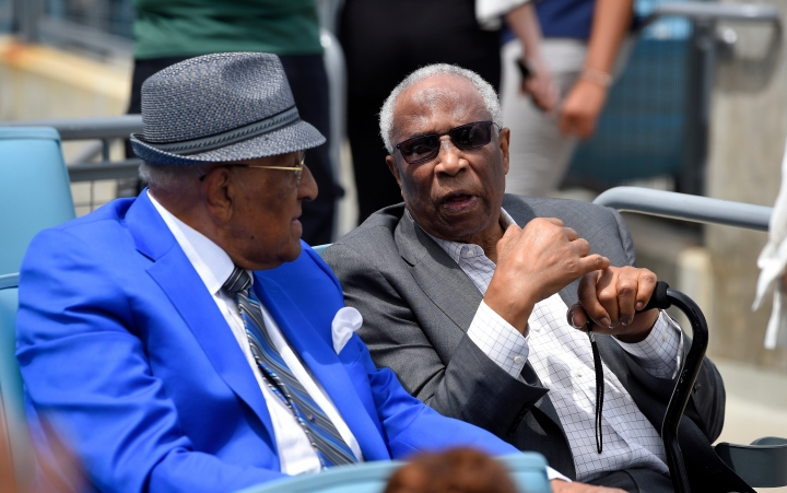 Former Dodger Don Newcombe, left, and former Orioles and Reds outfielder Frank Robinson talk prior to a baseball game between the Dodgers and the Arizona Diamondbacks Sunday, April 15, 2018, in Los Angeles. (AP Photo/Mark J. Terrill)