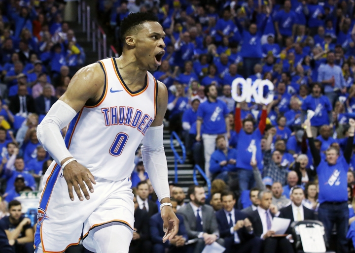 Oklahoma City Thunder guard Russell Westbrook (0) shouts after a dunk in the first half of Game 1 of an NBA basketball first-round playoff series against the Utah Jazz in Oklahoma City, Sunday, April 15, 2018. (AP Photo/Sue Ogrocki)