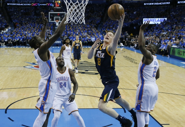 Utah Jazz forward Jonas Jerebko (8) shoots between Oklahoma City Thunder forward Jerami Grant, left, forward Patrick Patterson (54) and guard Raymond Felton (2) in the first half of Game 1 of an NBA basketball first-round playoff series in Oklahoma City, Sunday, April 15, 2018. (AP Photo/Sue Ogrocki)