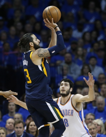 Utah Jazz guard Ricky Rubio (3) shoots in front of Oklahoma City Thunder guard Alex Abrines (8) in the first half of Game 1 of an NBA basketball first-round playoff series in Oklahoma City, Sunday, April 15, 2018. (AP Photo/Sue Ogrocki)