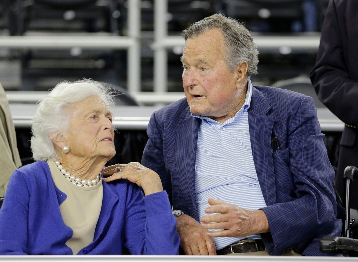 "FILE - In this March 29, 2015, file photo, former President George H.W. Bush and his wife Barbara Bush, left, speak before a college basketball regional final game between Gonzaga and Duke, in the NCAA basketball tournament in Houston. A family spokesman said Sunday, April 15, 2018, that the former first lady Barbara Bush is in ""failing health"" and won't seek additional medical treatment. (AP Photo/David J. Phillip, File)"