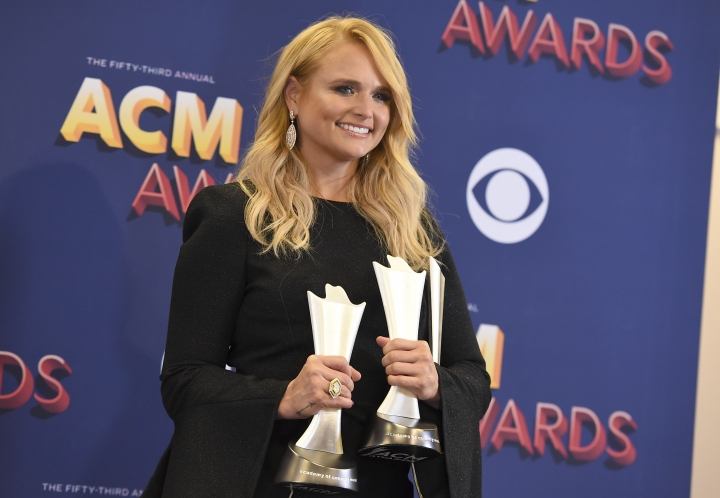 """Miranda Lambert poses in the press room with two awards for song of the year for """"Tin Man"""" as performer and song writer, and for female vocalist of the year at the 53rd annual Academy of Country Music Awards at the MGM Grand Garden Arena on Sunday, April 15, 2018, in Las Vegas. (Photo by Jordan Strauss/Invision/AP)"""