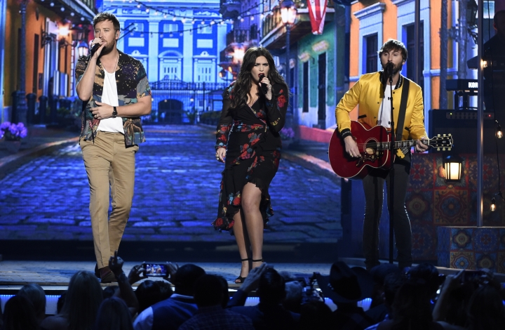 """Charles Kelley, from left, Hillary Scott and Dave Haywood, of Lady Antebellum, perform """"Heart Break"""" at the 53rd annual Academy of Country Music Awards at the MGM Grand Garden Arena on Sunday, April 15, 2018, in Las Vegas. (Photo by Chris Pizzello/Invision/AP)"""