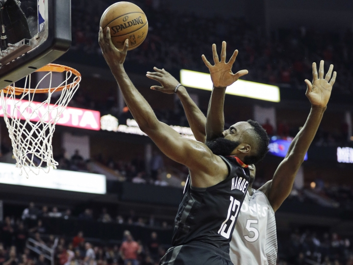 Minnesota Timberwolves' Gorgui Dieng, right, fouls Houston Rockets' James Harden during the second half in Game 1 of a first-round NBA basketball playoff series Sunday, April 15, 2018, in Houston. (AP Photo/David J. Phillip)