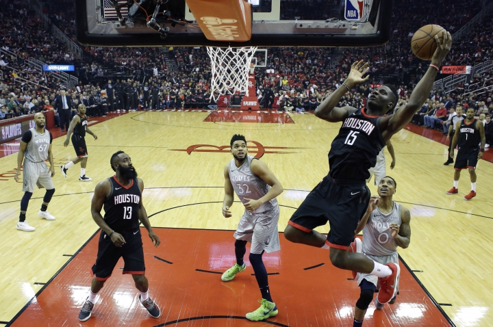 Houston Rockets' Clint Capela shoots over Minnesota Timberwolves' Jeff Teague (0) and Karl-Anthony Towns (32) during the first half in Game 1 of a first-round NBA basketball playoff series Sunday, April 15, 2018, in Houston. (AP Photo/David J. Phillip)