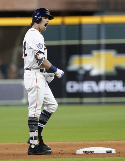 Houston Astros' Josh Reddick reacts at second base after hitting a double advancing Carlos Correa to third base in the eighth inning of a baseball game against the Texas Rangers, Sunday, April 15, 2018, in Houston. Both teams wore No. 42 in honor of Jackie Robinson Day. (AP Photo/Michael Wyke)