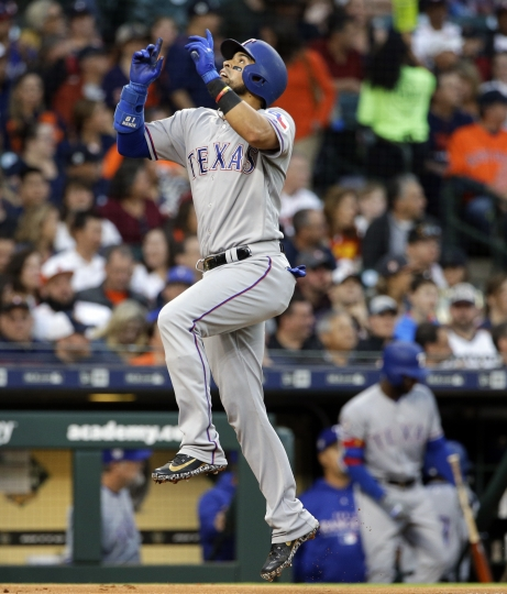 Texas Rangers Robinson Chirinos reacts as he crosses home plate after hitting a home run during the third inning of a baseball game against the Houston Astros Sunday, April 15, 2018, in Houston. (AP Photo/Michael Wyke)
