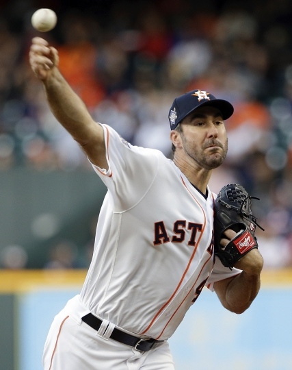 Houston Astros' starting pitcher Justin Verlander throws against the Texas Rangers during the first inning of a baseball game Sunday, April 15, 2018, in Houston. (AP Photo/Michael Wyke)