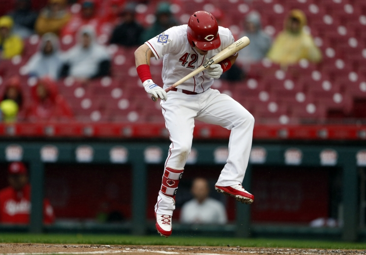 Cincinnati Reds' Scooter Gennett leaps out of the way of an inside pitch by St. Louis Cardinals starter Carlos Martinez during the first inning of a baseball game Sunday, April 15, 2018, in Cincinnati. (AP Photo/Gary Landers)