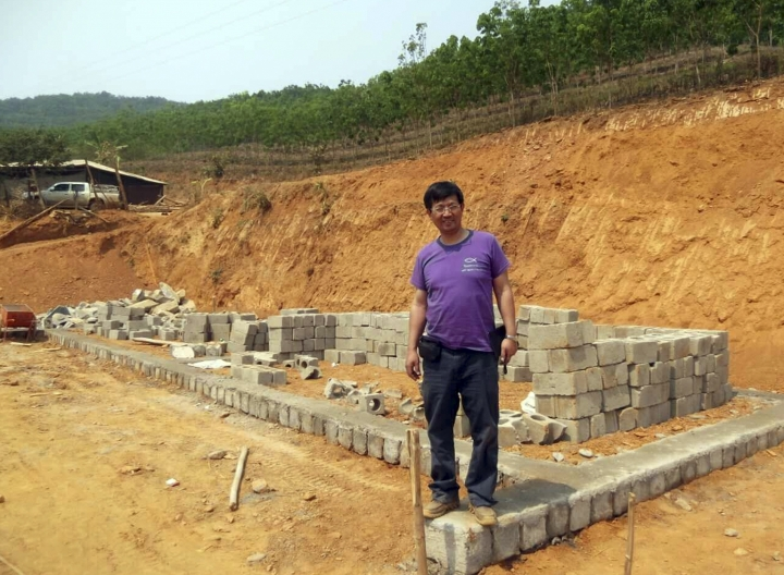 """In this May 2014, photo released by Ben Cao, Rev. John Sanqiang Cao breaks a ground on a new school in Wa State, Myanmar. The prominent Chinese pastor who has been detained by Chinese authorities since March 5, 2017 was sentenced in March 2018 to seven years in prison for """"organizing others to illegally cross the border."""" (Ben Cao via AP)"""