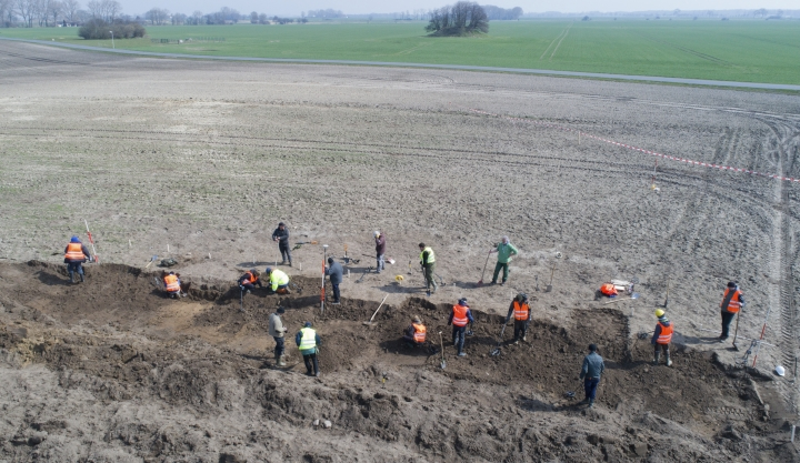 In this April 13, 2018 photo archaeologists search for coins and jewelry after a medieval silver treasure had been found near Schaprode on the northern German island of Ruegen in the Baltic Sea. (Stefan Sauer/dpa via AP)