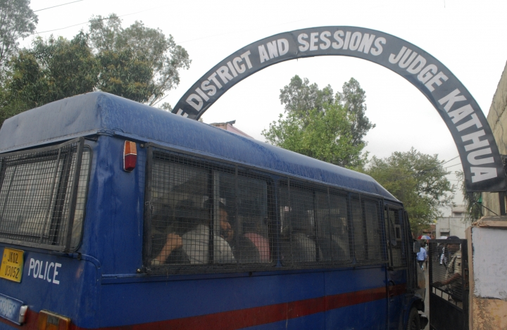 A police vehicle carrying the accused in the gang rape and killing of an 8-year-old Muslim girl arrives at the District and Sessions court in Kathua, Jammu and Kashmir, India, Monday, April 16, 2018. Eight Hindu men accused in the case have pleaded not guilty in their first court appearance. Monday's court appearance comes as angry protests over the case have spread across the country. (AP Photo)