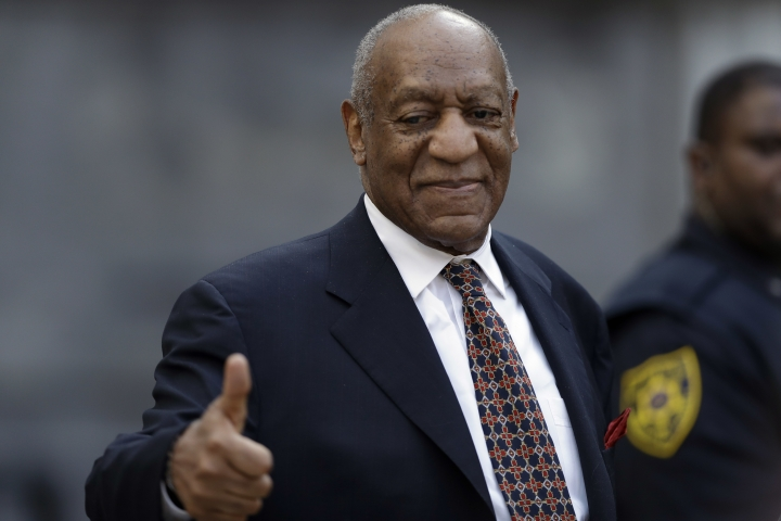 Bill Cosby gestures to supporters as he departs his sexual assault trial, Friday, April 13, 2018, at the Montgomery County Courthouse in Norristown, Pa. (AP Photo/Matt Slocum)