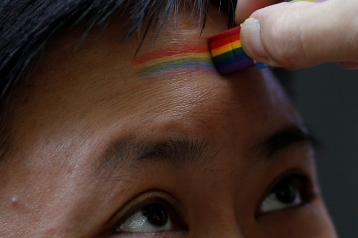 FILE PHOTO: A participant takes part in a Pride Run, an event of the ShanghaiPRIDE LGBT celebration in Shanghai, China June 17, 2017. REUTERS/Aly Song