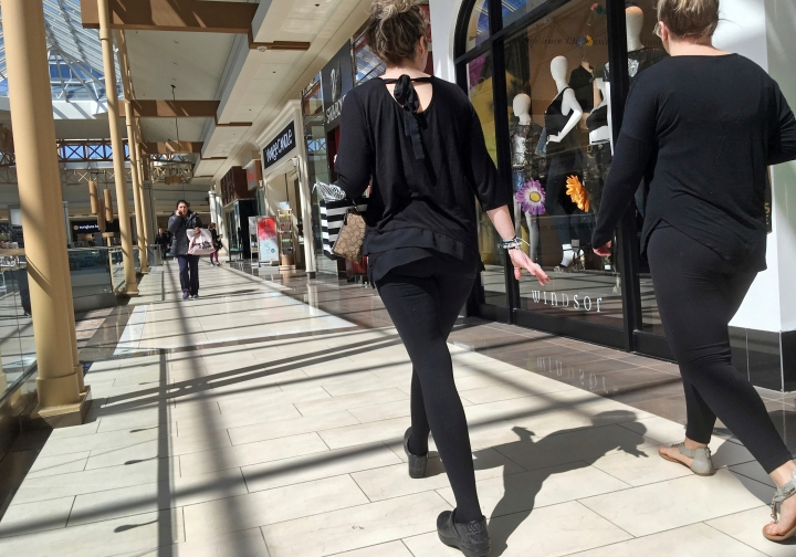 FILE- In this April 9, 2018, file photo, shoppers walk in a mall in Salem, N.H. On Monday, April 16, the Commerce Department releases U.S. retail sales data for March. (AP Photo/Elise Amendola, File)