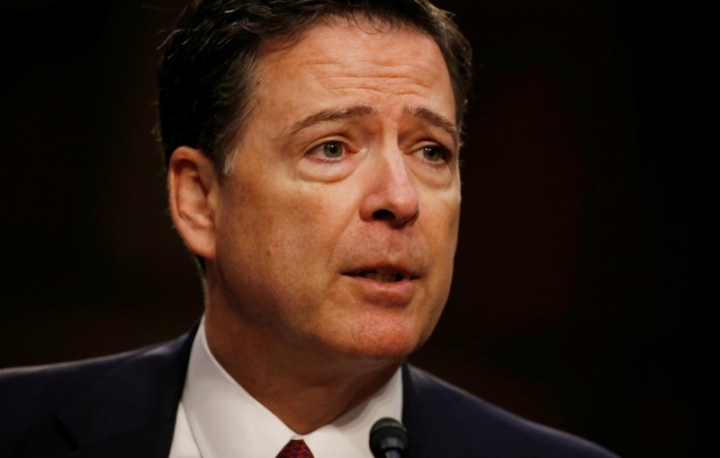 FILE PHOTO: Former FBI Director James Comey testifies before a Senate Intelligence Committee hearing on Russia's alleged interference in the 2016 U.S. presidential election on Capitol Hill in Washington, U.S., June 8, 2017.   REUTERS/Jonathan Ernst/File Photo