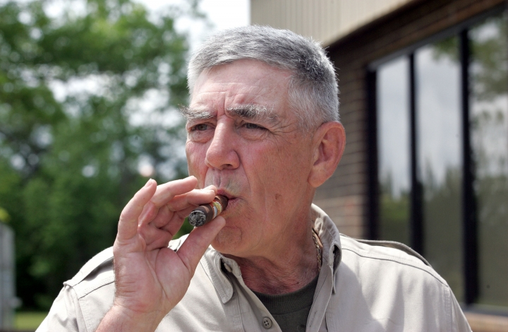 "FILE - In this May 15, 2006, file photo, retired Marine Gunnery Sgt. R. Lee Ermey takes a break for a smoke outside New River Air Station's Staff NCO club in Jacksonville, N.C. Ermey, a former marine who made a career in Hollywood playing hard-nosed military men like Gunnery Sgt. Hartman in Stanley Kubrick's ""Full Metal Jacket,"" has died. His longtime manager Bill Rogin says he died Sunday morning, April 15, 2018, from pneumonia-related complications. He was 74. (Randy Davey/The Jacksonville Daily News via AP, File)"