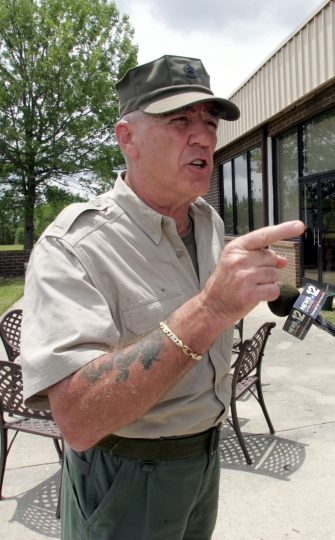 """FILE - In this May 15, 2006, file photo, retired Marine Gunnery Sgt. R. Lee Ermey gives a few Marines a show outside New River Air Station's Staff NCO club in Jacksonville, N.C. Ermey, a former marine who made a career in Hollywood playing hard-nosed military men like Gunnery Sgt. Hartman in Stanley Kubrick's """"Full Metal Jacket,"""" has died. His longtime manager Bill Rogin says he died Sunday morning, April 15, 2018, from pneumonia-related complications. He was 74. (Randy Davey/The Jacksonville Daily News via AP, File)"""