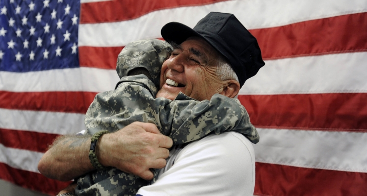"FILE - In this Feb. 11, 2012, file photo, R. Lee Ermey gets a surprise hug from 4-year-old Bryant Teat, who ran up to Ermey and hugged him after Ermey signed an autograph in Hoover, Ala. Ermey, a former marine who made a career in Hollywood playing hard-nosed military men like Gunnery Sgt. Hartman in Stanley Kubrick's ""Full Metal Jacket,"" has died. His longtime manager Bill Rogin says he died Sunday morning, April 15, 2018, from pneumonia-related complications. He was 74. (Joe Songer/AL.com via AP, File)"
