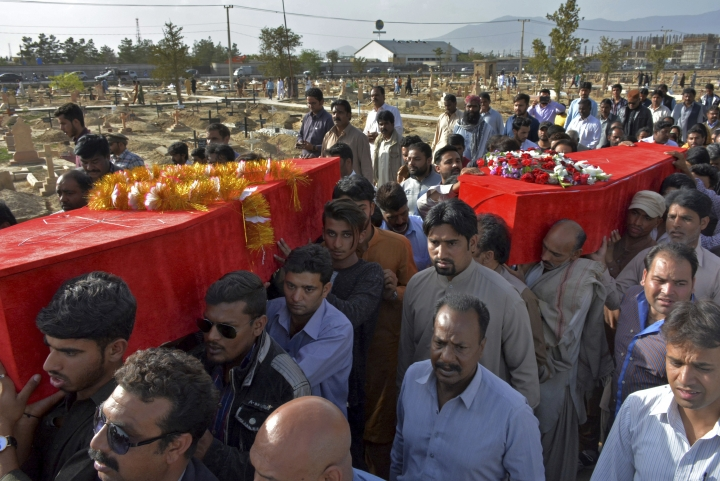 People attend funeral of Family Pakistani Christian worshippers who were killed by gunmen, in Quetta, Pakistan, Monday, April 16, 2018. The Human Rights Commission of Pakistan, an independent Pakistani watchdog criticized the country's human rights record over the past year in a new report released Monday that said the nation has failed to make progress on a myriad of issues, ranging from forced disappearances, to women's rights and protection of religious minorities. (AP Photo/Arshad Butt)