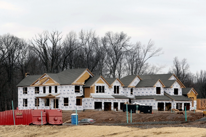 FILE- In this Feb. 26, 2018, file photo, work continues on a new development in Franklin Lakes, N.J. On Monday, April 16, the National Association of Home Builders/Wells Fargo releases its March index of builder sentiment. (AP Photo/Seth Wenig)