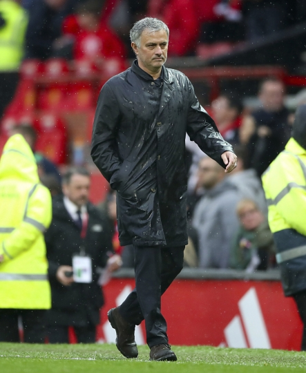 Manchester United manager Jose Mourinho leaves the pitch after the final whistle of the English Premier League soccer match against West Bromwich Albion at Old Trafford, Manchester, England, Sunday April 15, 2018. (Nick Potts/PA via AP)