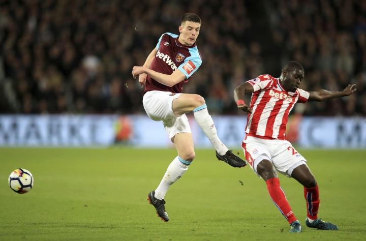 Stoke City's Badou Ndiaye, right, and West Ham United's Declan Rice, during the English Premier League soccer match at London Stadium, Monday April 16, 2018. (Adam Davy/PA via AP)