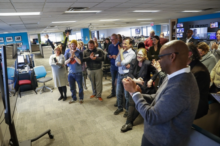 "The staff of the Cincinnati Enquirer gather to celebrate in their newsroom after learning the newspaper won the Pulitzer Prize for Local Reporting for ""Seven Days of Heroin,"" a week-long examination of the many ways the heroin crisis is impacting their community, Monday, April 16, 2018, in Cincinnati. (AP Photo/John Minchillo)"