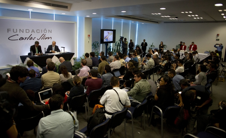 Journalists attend a press conference with Mexican billionaire Carlos Slim in Mexico City, Monday, April 16, 2018. Slim says he would be concerned if leftist presidential candidate Andres Manuel Lopez Obrador wins the July 1 presidential election and cancels the new Mexico City airport project. (AP Photo/Eduardo Verdugo)