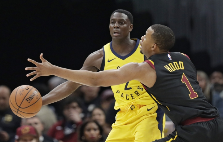 Indiana Pacers' Darren Collison (2) passes around Cleveland Cavaliers' Rodney Hood (1) in the first half of Game 1 of an NBA basketball first-round playoff series, Sunday, April 15, 2018, in Cleveland. (AP Photo/Tony Dejak)