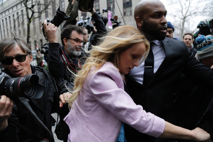 Porn actress Stormy Daniels arrives at federal court, Monday, April 16, 2018, in New York. A U.S. judge will hear more arguments about President Donald Trump's extraordinary request that he be allowed to review records seized from his lawyer, Michael Cohen, office as part of a criminal investigation before they are examined by prosecutors. The raid carried out last Monday at Cohen's apartment, hotel room, office and safety deposit box sought bank records, records on Cohen's dealing in the taxi industry, Cohen's communications with the Trump campaign and information on payments made in 2016 to former Playboy model Karen McDougal and to Daniels. (AP Photo/Seth Wenig)