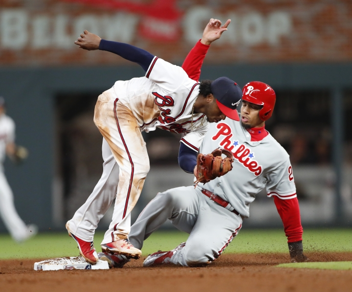 Philadelphia Phillies' Aaron Altherr (23) is forced out at second base byAtlanta Braves second baseman Ozzie Albies (1) on a Maikel Franco ground ball in the eighth inning of a baseball game Monday, April 16, 2018, in Atlanta. The Braves won 2-1. (AP Photo/John Bazemore)