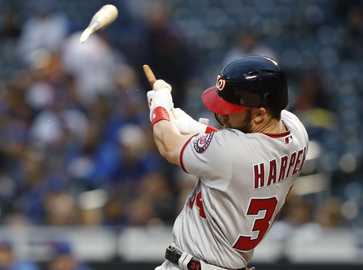 Washington Nationals' Bryce Harper hits a solo home run in the first inning of a baseball game against the New York Mets, Monday, April 16, 2018, in New York. (AP Photo/Kathy Willens)